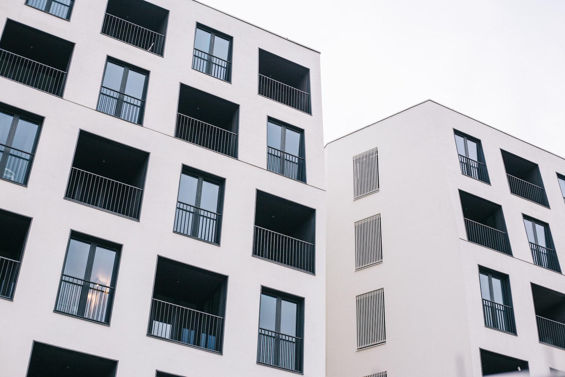 The exterior of a white condominium building